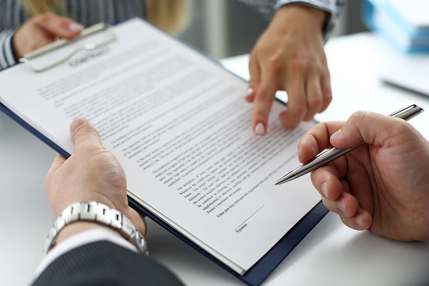 real-estate-clerk-offering-visitor-document-sign-827px