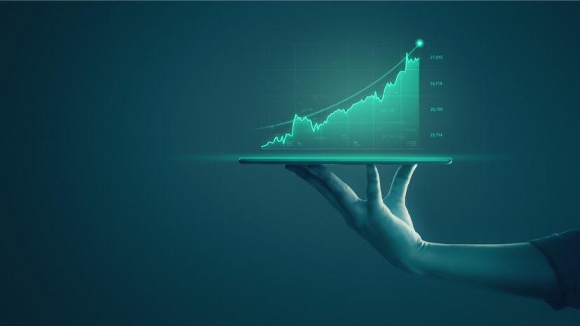 businessman-holding-tablet-showing-holographic-graphs-stock-market-statistics-gain-profits